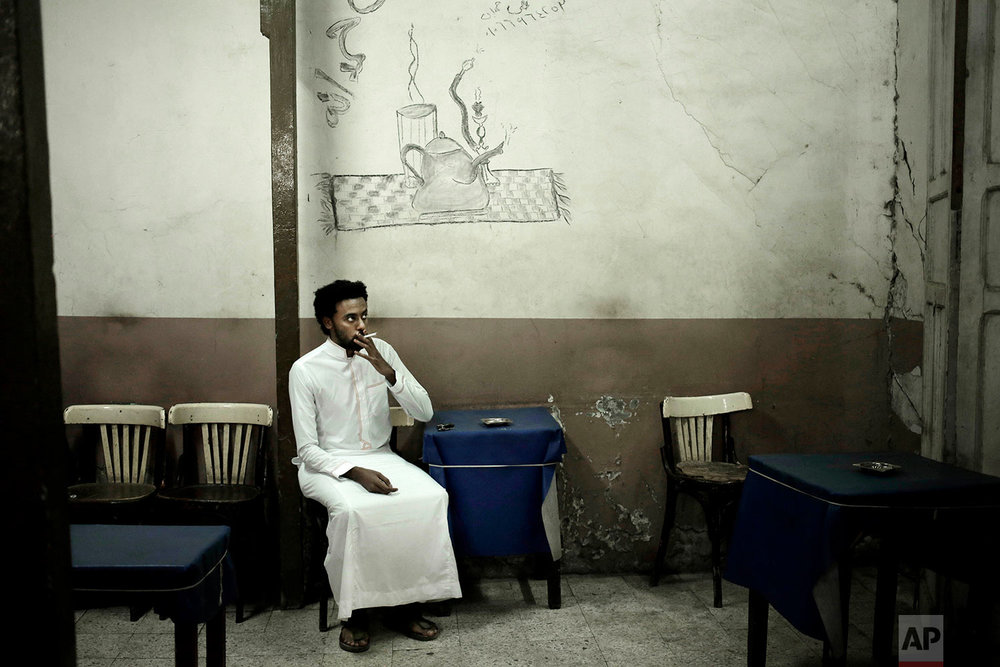 30-year old Nubian activist Mazen Alaa from the Fajeky tribe smokes a cigarette at a local cafe, in Aswan, Egypt. (AP Photo/Nariman El-Mofty)