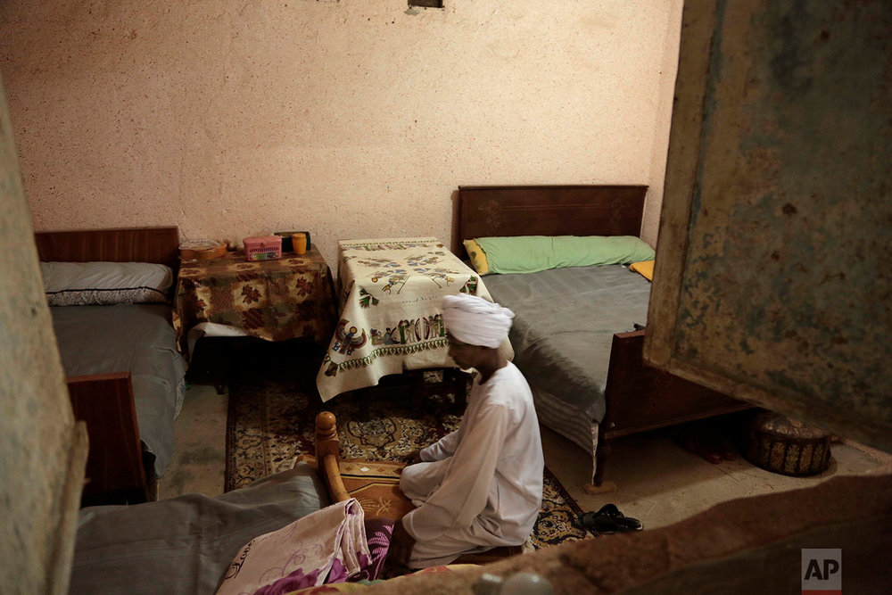 "Sheikh Mohammed prays in his home in the ""tahgeer"" Eneiba village, northern Aswan, Egypt. (AP Photo/Nariman El-Mofty)"