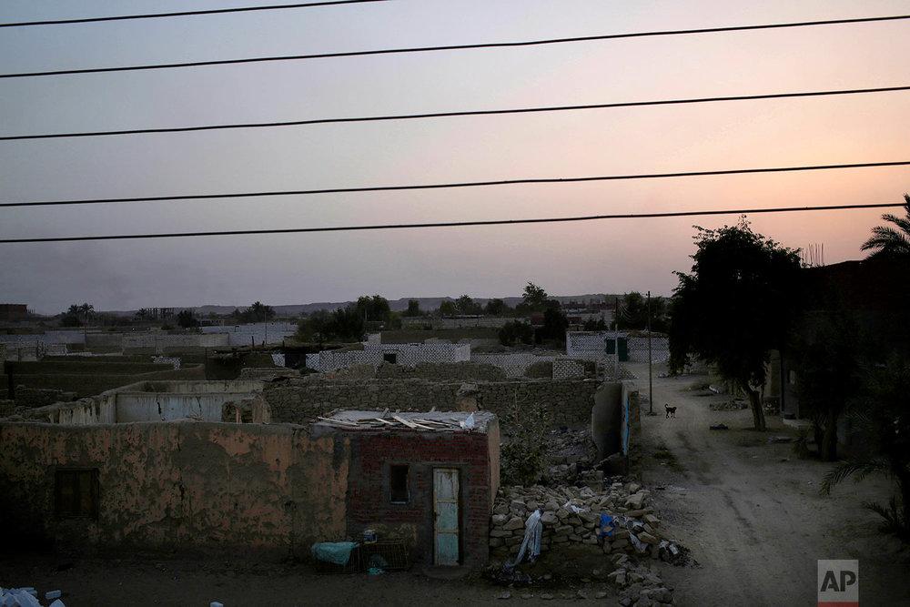 "The sun sets in ""tahgeer"" Eneiba village, northern Aswan, Egypt. (AP Photo/Nariman El-Mofty)"