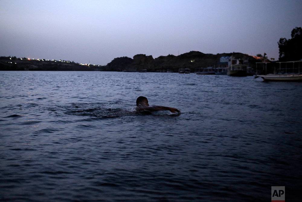 A Nubian man swims in the Nile River on Heisa Island, in Aswan, Egypt. (AP Photo/Nariman El-Mofty)