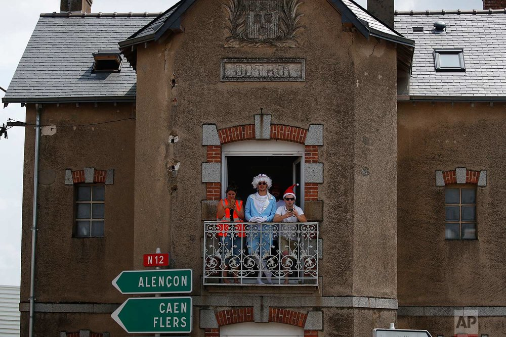 Spectators wait for the riders to pass during the seventh stage of the Tour de France cycling race over 231 kilometers (143.5 miles) with start in Fougeres and finish in Chartres, France, France, Friday, July 13, 2018. (AP Photo/Christophe Ena)