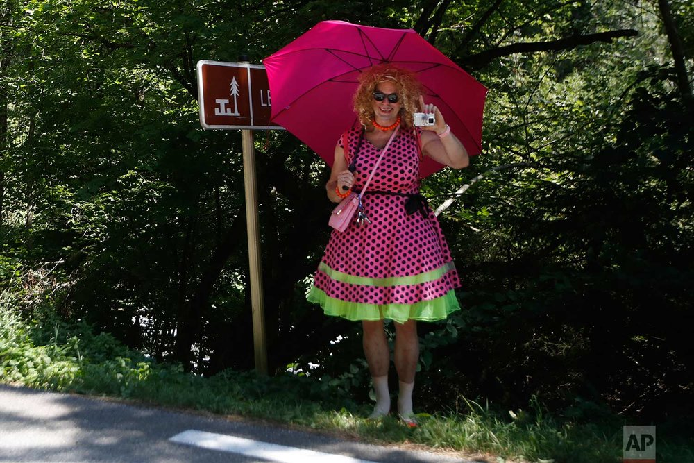 A spectator waits for the riders to pass during the eleventh stage of the Tour de France cycling race over 108.5 kilometers (67.4 miles) with start in Albertville and finish in La Rosiere Espace San Bernardo, France. (AP Photo/Christophe Ena )
