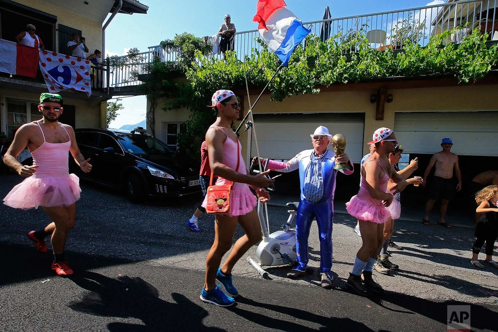 Fans wait for the riders to pass during the tenth stage of the Tour de France cycling race over 158.8 kilometers (98.7 miles) with start in Annecy and finish in Le Grand-Bornand, France, Tuesday, July 17, 2018. (AP Photo/Peter Dejong)