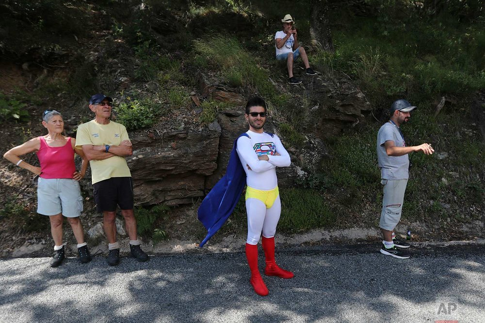 Fans wait for the riders to pass during the fourteenth stage of the Tour de France cycling race over 188 kilometers (116.8 miles) with start in Saint-Paul Trois-Chateaux and Mende, France, Saturday July 21, 2018. (AP Photo/Peter Dejong)