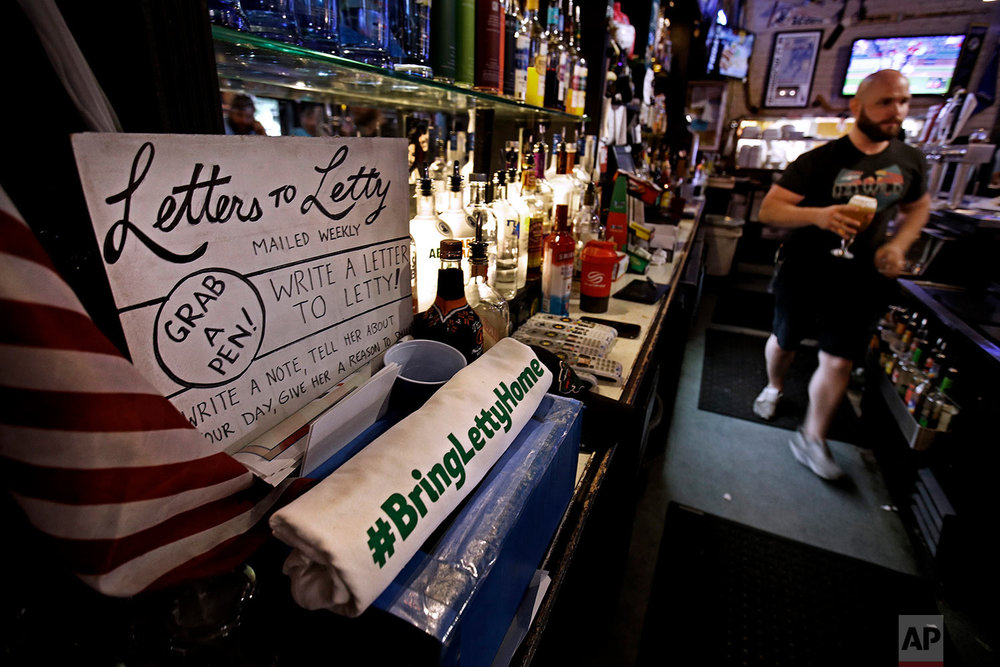Customers are encouraged to write letters to Letty Stegall, the general manager of The Blue Line hockey bar in Kansas City, Mo. (AP Photo/Charlie Riedel)