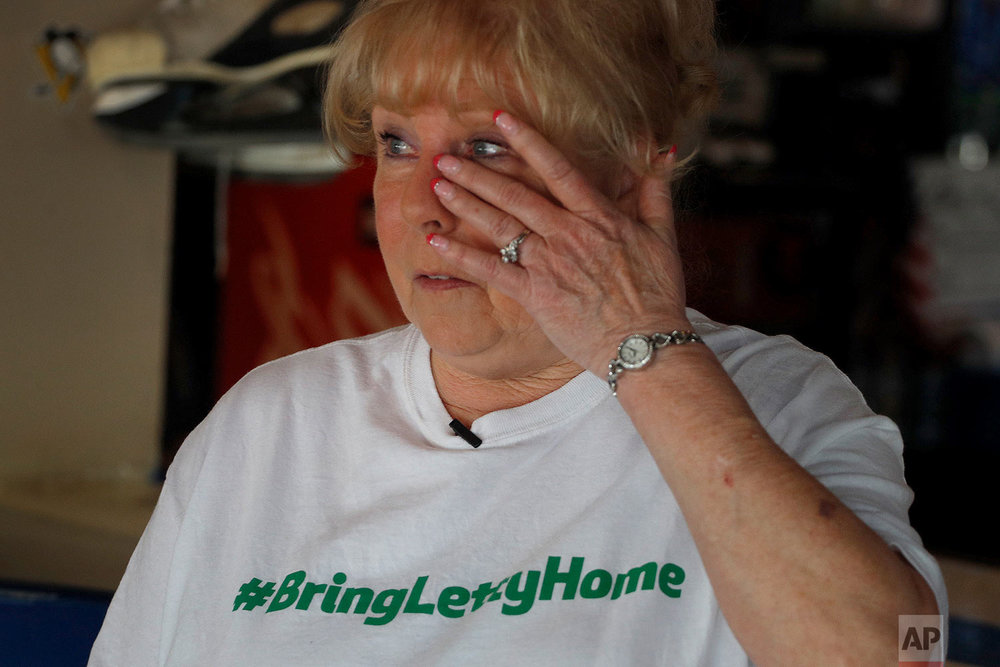 Shirley Stegall talks about her daughter-in-law, Letty Stegall, at the hockey bar that Shirley owns and Letty managed in Kansas City, Mo. (AP Photo/Charlie Riedel)