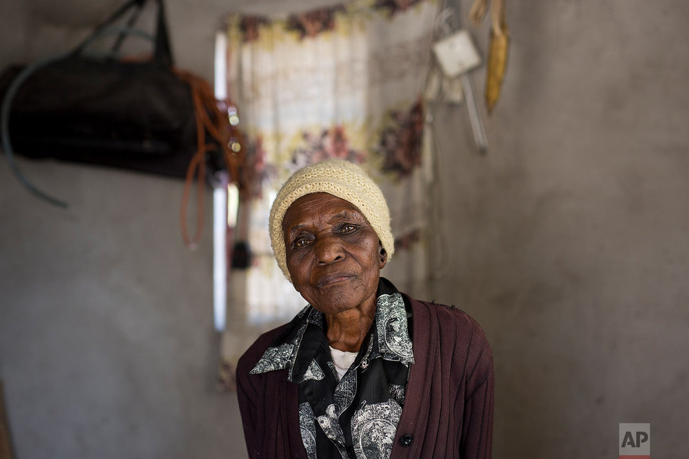 Ellis Ndlovu, 91, poses for a photograph in her Simbumbumbu, Zimbabwe home. (AP Photo/Jerome Delay)