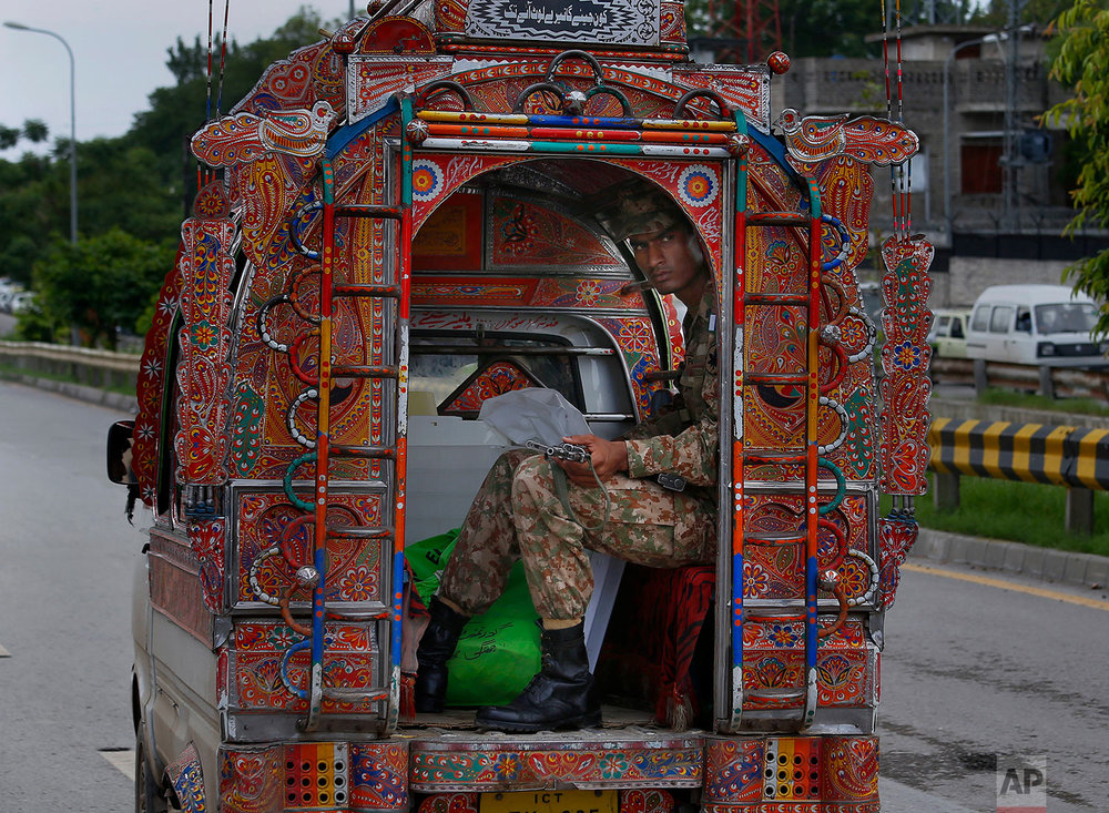 A Pakistani soldier guards to polling material transported to polling stations, in Rawalpindi, Pakistan, Tuesday, July 24, 2018. (AP Photo/Anjum Naveed)