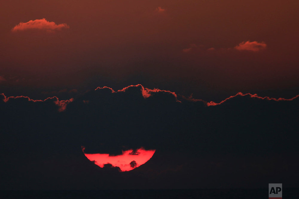 The sun sets over the Mediterranean Sea off the coast of Ashdod, Israel, Sunday, July 29, 2018. (AP Photo/Ariel Schalit)
