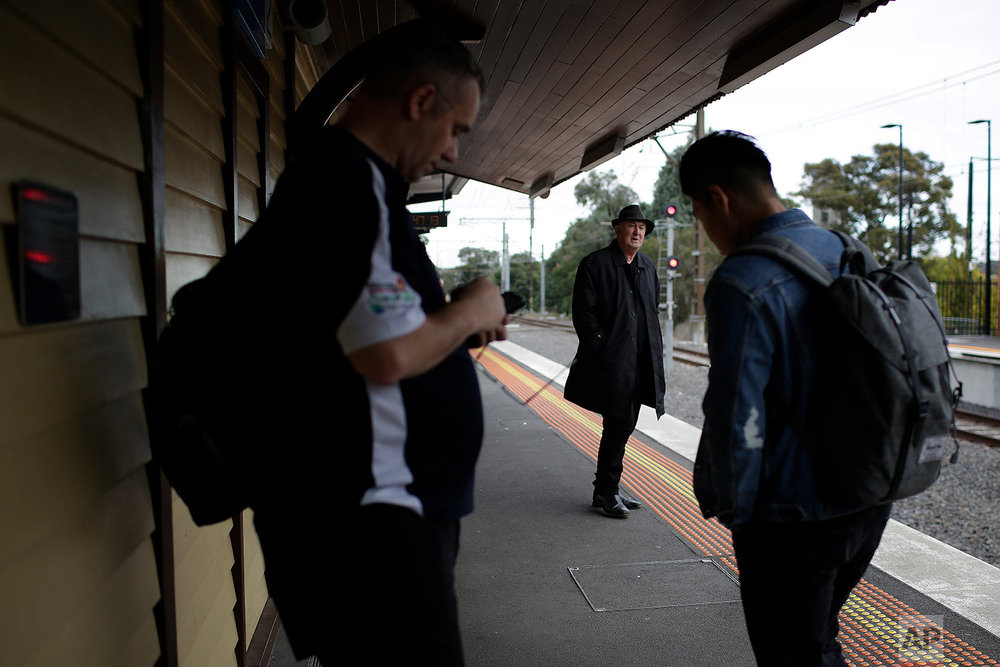Peter Peacock waits for the train as part of his hour-long journey into the city from his home, to meet with Gypsy Diamond, 36, in Melbourne Australia. (AP Photo/Wong Maye-E)