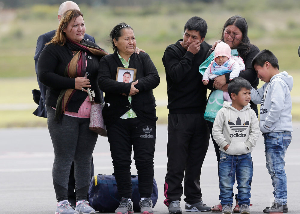Relatives and friends wait for the remains of Katty Velasco and Oscar Villacis, to arrive at the Mariscal Sucre airport in Quito, Ecuador, July 6, 2018. The two were kidnapped three months ago and later killed by a dissident group of the Revolutionary Armed Forces of Colombia on the border with Colombia. (AP Photo/Dolores Ochoa)