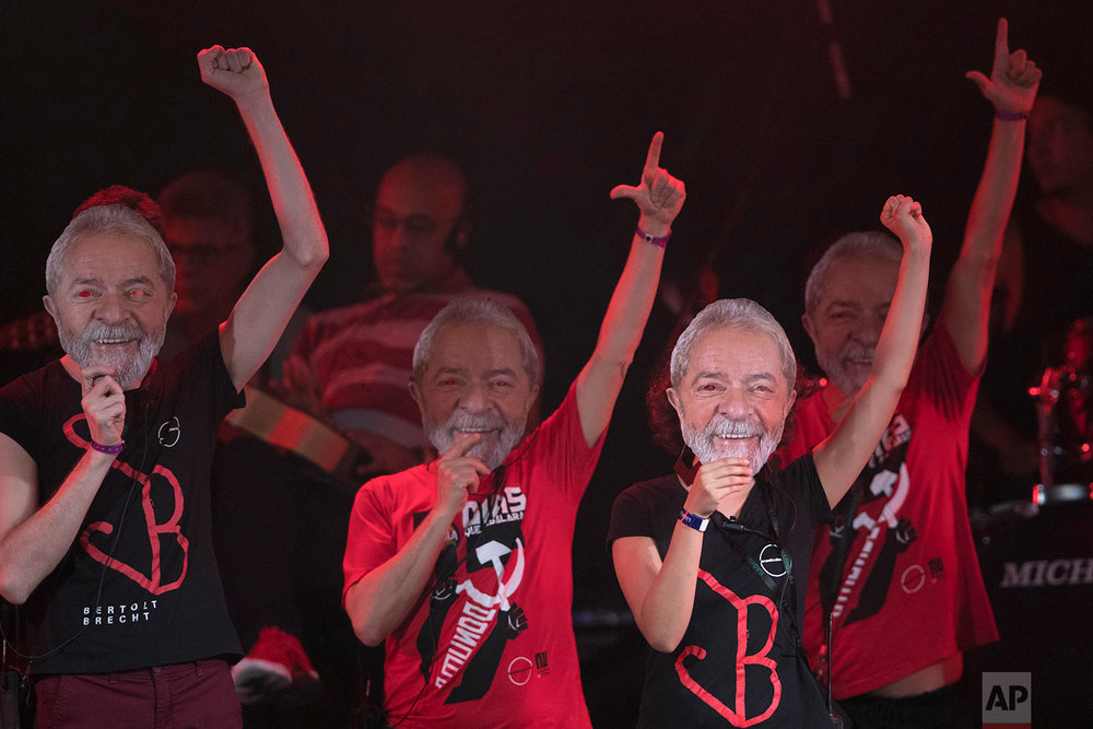 Artists with masks of former Brazilian President Luiz Inacio da Silva perform at the Lula Free festival in Rio de Janeiro, Brazil, July 28, 2018. Popular Brazilian musicians and social movements organized a concert to call for the release of Da Silva, who has been in prison since April but continues to lead the polls ahead of October's election. (AP Photo/Leo Correa)