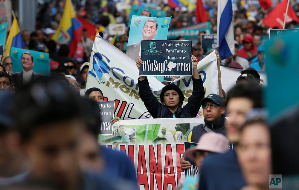 Supporters of former President Rafael Correa rally in his favor after a judge ordered him jailed for failing to appear in court as required as part of a kidnapping probe in Quito, Ecuador, July 5, 2018. (AP Photo/Dolores Ochoa)