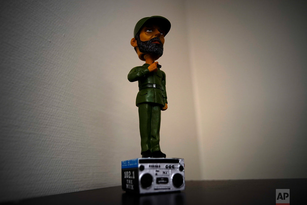 "A bobblehead statue of Fidel Castro on a radio is for sale at the naval base at Guantanamo Bay, June 5, 2018. GTMO Radio's motto is ""Rockin' in Fidel's Backyard."""