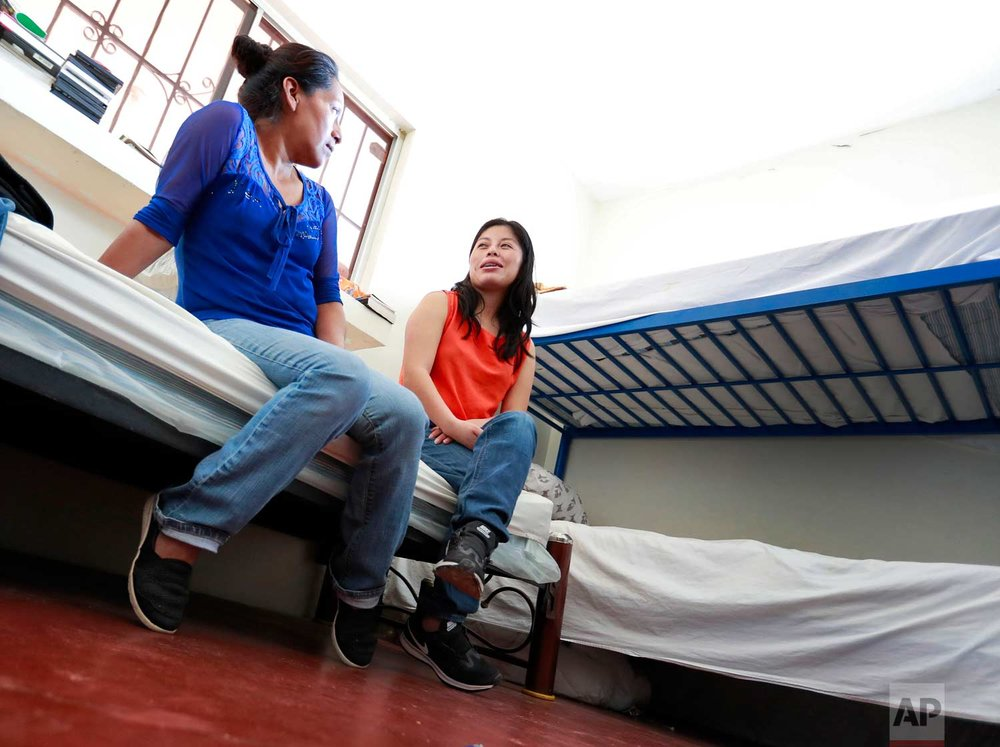 """Mexican nationals Maria Dolores Cabrera Mauricio, right, and Angela Francisco Mendoza talk in the ladies dormitory of the Asociacion Casa Del Migrante """"La Divina Providencia"""" group house Thursday, July 19, 2018 in San Luis, Sonora, Mexico. Thousands of families and unaccompanied children are continuing to cross the U.S. border in Arizona and California even after learning of the government's family separation policy upon apprehension. (AP Photo/Matt York)"""