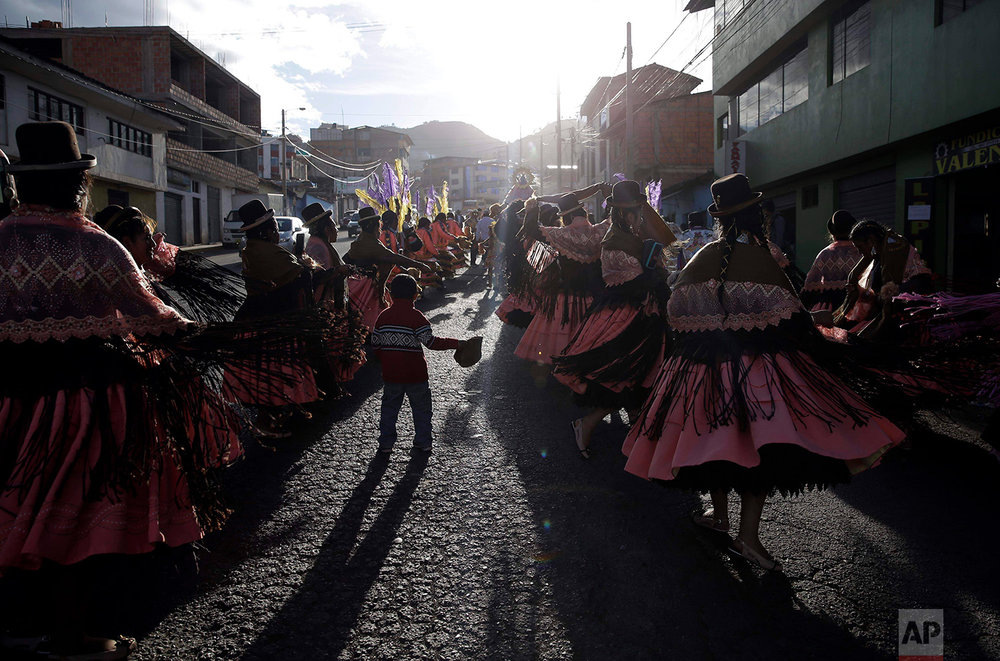 "Dance troupes perform the ""Morenada"" or Dance of the Black Slaves, during celebrations honoring Our Lady of Copacabana, in Cuzco, Peru, Aug. 5, 2018. The traditional Bolivian dance is comprised of a synergistic mix of African and Aymara influences. (AP Photo/Martin Mejia)"