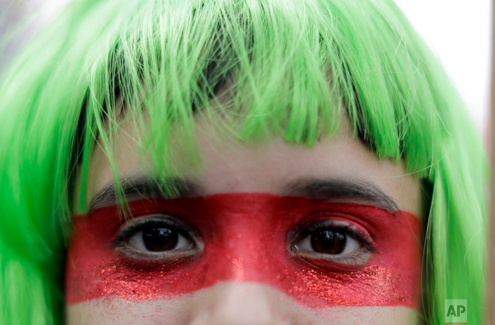 A demonstrator in support of decriminalizing abortion stands outside the congress building in Buenos Aires, Argentina, Wednesday, Aug. 8, 2018. Following months of increasingly tense debate, lawmakers in Argentina met on Wednesday ahead of a vote on a bill that would decriminalize abortions up to the first 14 weeks of pregnancy. (AP Photo/Natacha Pisarenko)