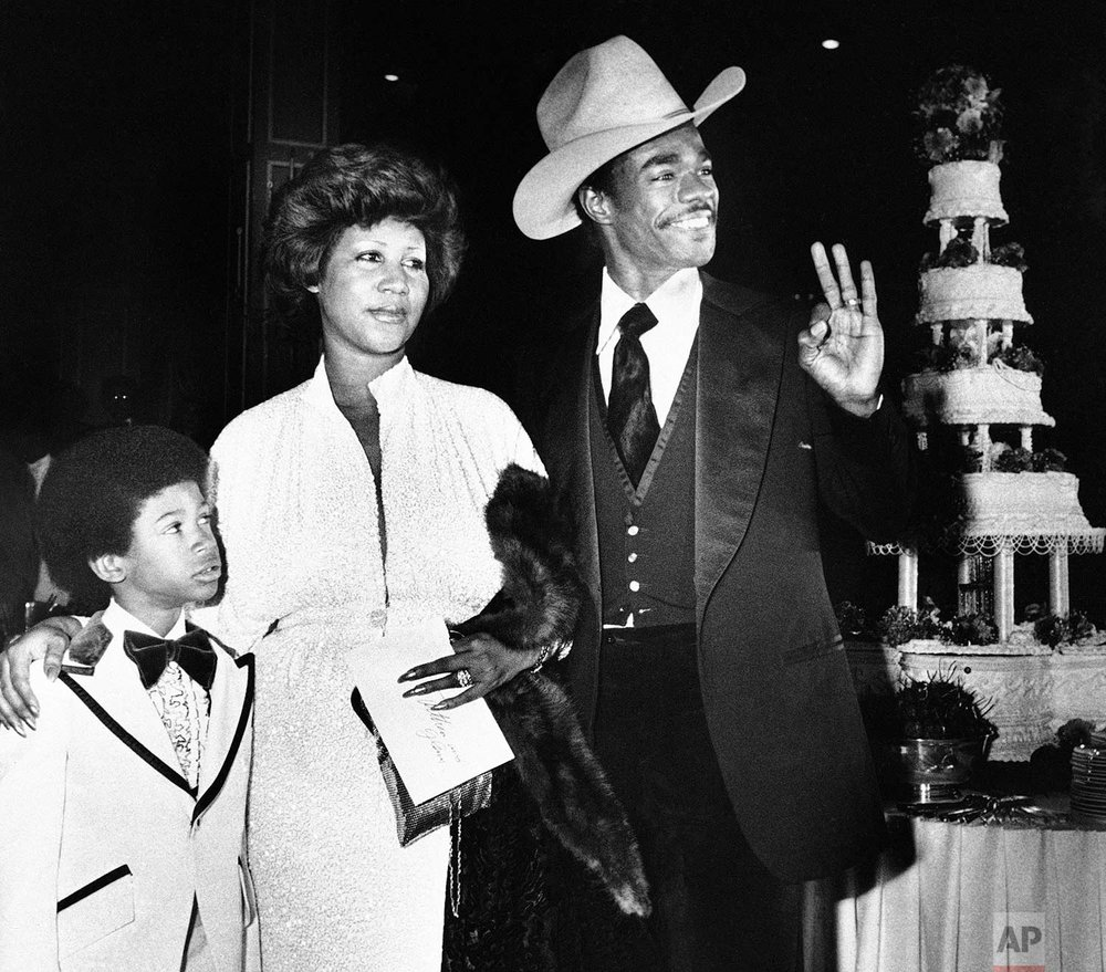 Aretha Franklin and her new husband, Glen Turman, arrive at a Los Angeles hotel, April 17, 1978 for their wedding reception. (AP Photo/Doug Pizac)