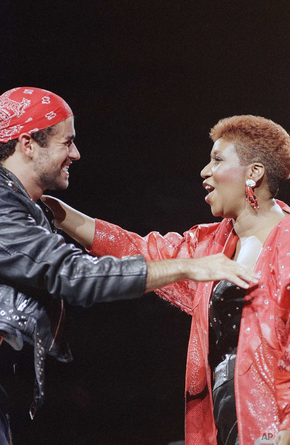 Singing great Aretha Franklin joins George Michael on stage during his Faith World Tour in the Detroit area at the Palace of Auburn Hills, Aug. 30, 1988. (AP Photo/Rob Kozloff)