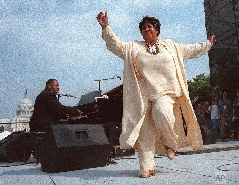 Singer Aretha Franklin dances on stage during the first annual march on cancer Saturday, Sept. 26, 1998, in Washington. (AP Photo/Khue Bui)