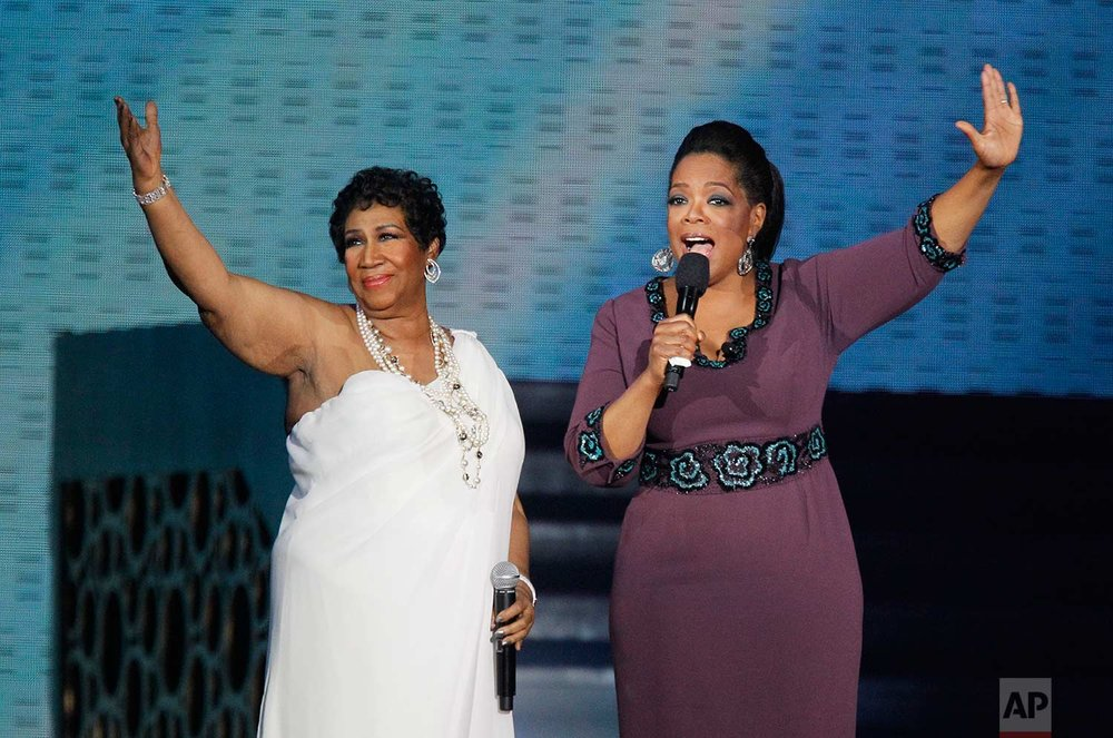 "Aretha Franklin and Oprah Winfrey acknowledge fans during a star-studded double-taping of ""Surprise Oprah! A Farewell Spectacular,"" Tuesday, May 17, 2011, in Chicago.(AP Photo/Charles Rex Arbogast)"
