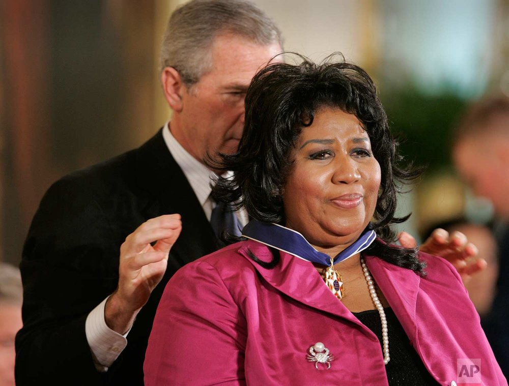 President Bush awards singer Aretha Franklin the Presidential Medal of Freedom Award in the East Room of the White House, Wednesday, Nov. 9, 2005, in Washington. (AP Photo/Lawrence Jackson)