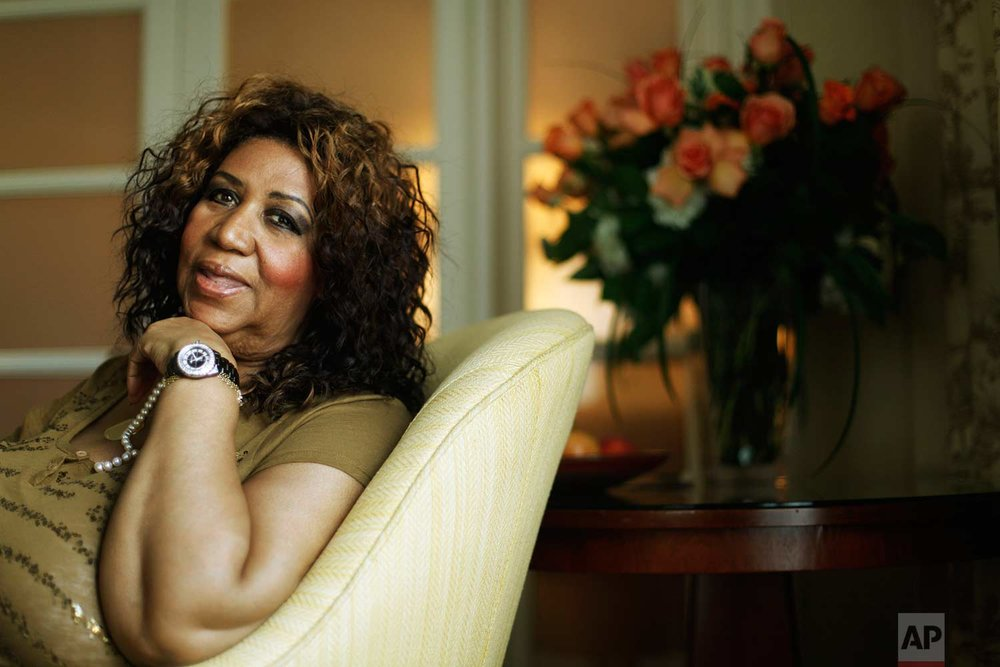 Performer Aretha Franklin poses for a photograph in Philadelphia, Monday, July 26, 2010. (AP Photo/Matt Rourke)