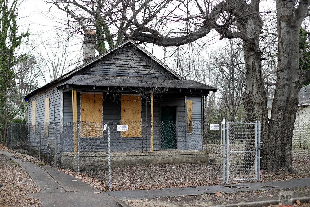 The abandoned childhood home of singer Aretha Franklin sits behind a security fence in Memphis, Tenn, Jan. 16, 2017 photo, . (AP Photo/Mark Humphrey)