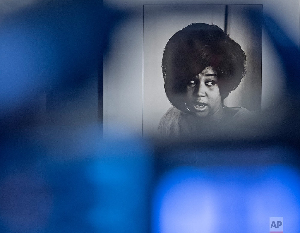 The photo of Aretha Franklin by Linda McCartney is seen behind a camera during the press preview at the exhibition 'Sixties' by Linda McCartney in the Avant-garde House of Art in Apolda, Germany, Friday, April 8, 2016. (AP Photo/Jens Meyer)