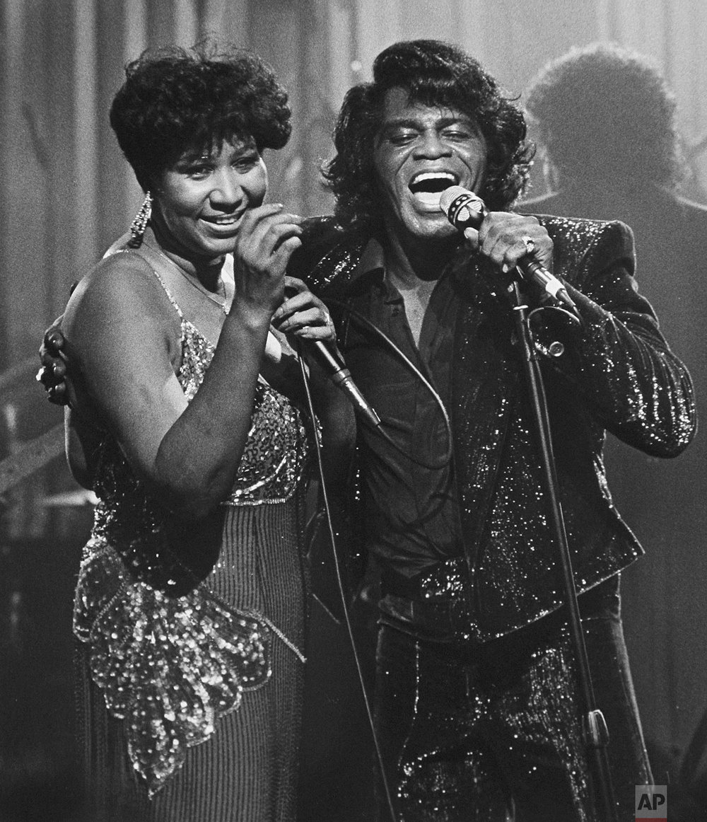 Soul singers James Brown and Aretha Franklin sing during a Home Box Office taping at the Taboo night club in Detroit, Jan. 11, 1987. (AP Photo/Rob Kozloff)