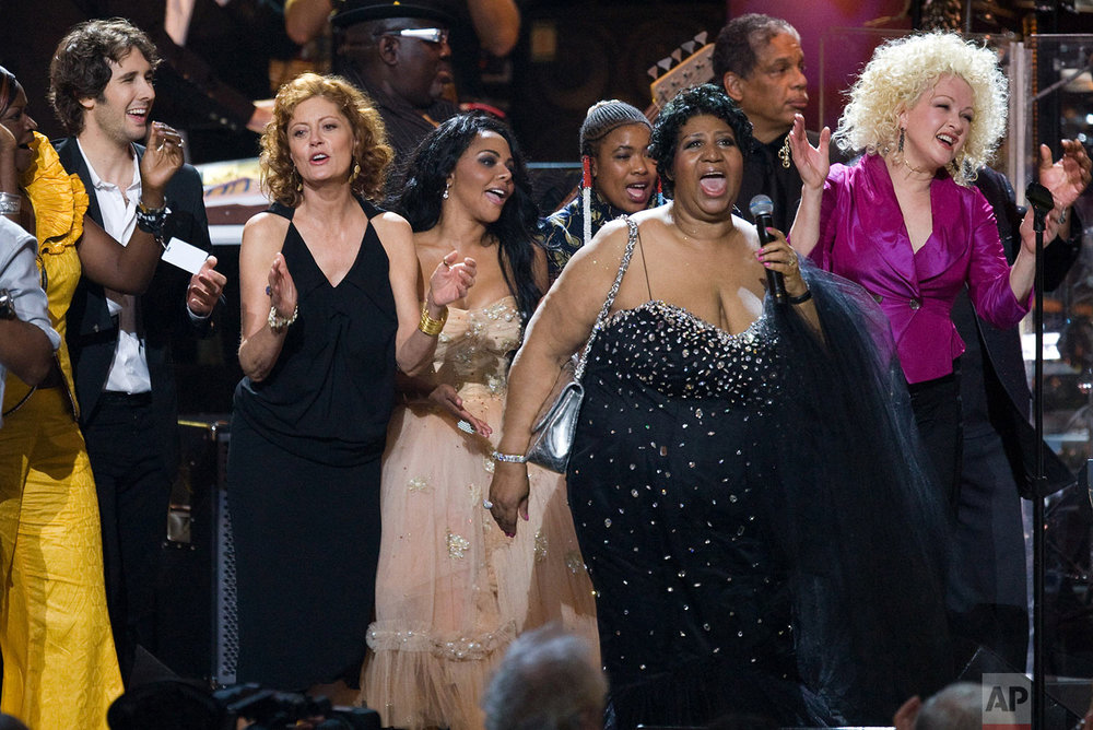 Josh Groban, Susan Sarandon, Little Kim, Aretha Franklin and Cyndi Lauper gather on stage for the finale of the 'Mandela Day' Concert to celebrate Nelson Mandela's 91st birthday at Radio City Music Hall in New York, Saturday, July 18, 2009. (AP Photo/Charles Sykes)