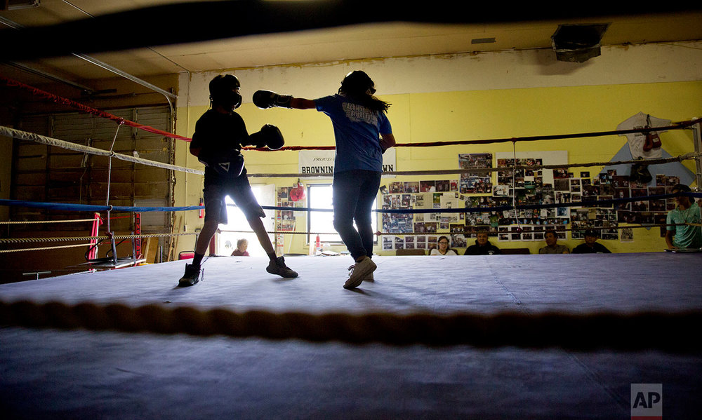 "Beatrice Kipp, 13, right, spars with Timmy Sellars, 14, at the Blackfeet Native Boxing Club on the Blackfeet Indian Reservation in Browning, Mont., July 14, 2018. ""I'm protective of our children because of human trafficking. What happened to Ashley is really worrying,"" said Frank  Kipp , who teaches his daughters how to box and runs the club. ""We teach our girls if someone grabs you, you fight to your death."" (AP Photo/David Goldman)"