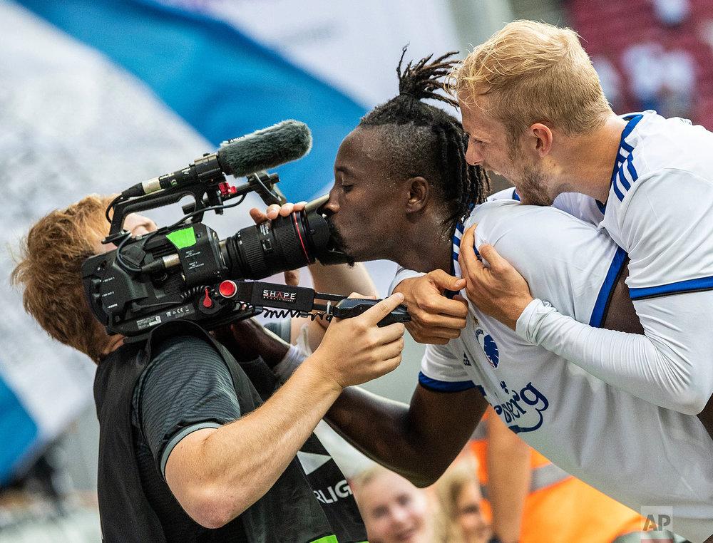 Dame N'Doye of FC Copenhagen kisses a camera as he celebrates bringing the score to 2-1 against CSKA Sofia, during their Europa League soccer match in Copenhagen, Denmark, on Thursday, Aug. 16, 2018. (Anders Kjaerbye/Ritzau Scanpix via AP)