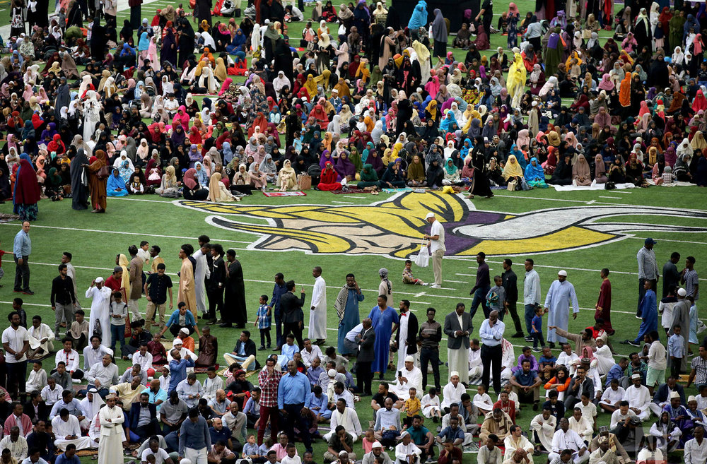 Muslim worshipers gather on the field for morning prayers Tuesday, Aug. 21, 2018, at U.S. Bank Stadium, in Minneapolis. The four-hour prayer service is hosted by Super Eid Inc., a group of local Muslim organizations that celebrate the holiday together every year in Minneapolis, according to one of the event organizers. The annual event has been held at the Minneapolis Convention Center for the past decade. This is the first year the prayer will take place at the stadium. (David Joles/Star Tribune via AP)