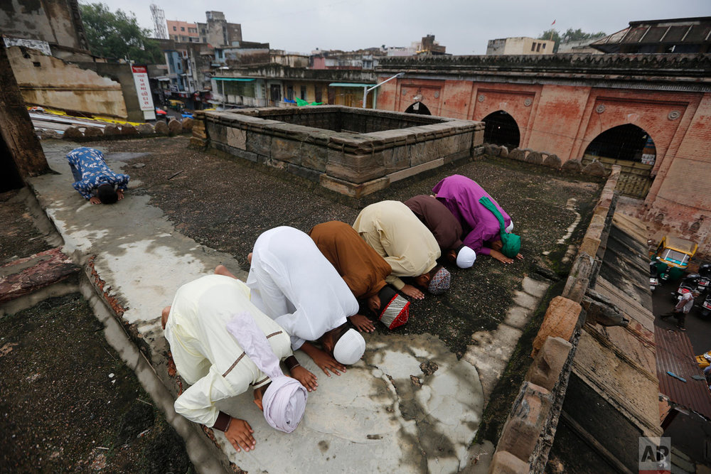 Muslims offer Eid al-Adha prayers at Jama Mosque in Ahmadabad, India, Wednesday, Aug. 22, 2018. Muslims around the world celebrate Eid al-Adha, or the Feast of the Sacrifice, by sacrificing animals to commemorate the prophet Ibrahim's faith in being willing to sacrifice his son. (AP Photo/Ajit Solanki)