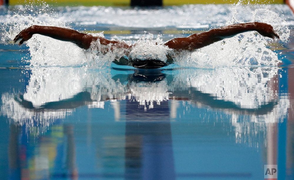 India's Sajan Prakash swims in his heat of the men's 100m butterfly during the swimming competition at the 18th Asian Games in Jakarta, Indonesia, Wednesday, Aug. 22, 2018. (AP Photo/Lee Jin-man)