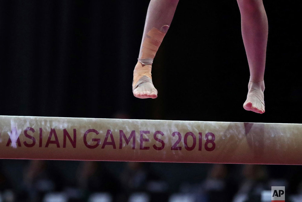 Taiwan's Lai Pin Ju competes on the balance beam during the women's all-around gymnastics competition at the 18th Asian Games Jakarta, Indonesia, Tuesday, Aug. 21, 2018. (AP Photo/Dita Alangkara)