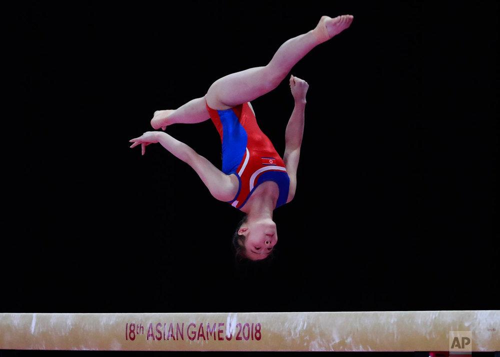 North Korea's Jon Jang Mi competes on the balance beam during the women's team gymnastics final at the 18th Asian Games in Jakarta, Indonesia, Wednesday, Aug. 22, 2018. (AP Photo/Dita Alangkara)