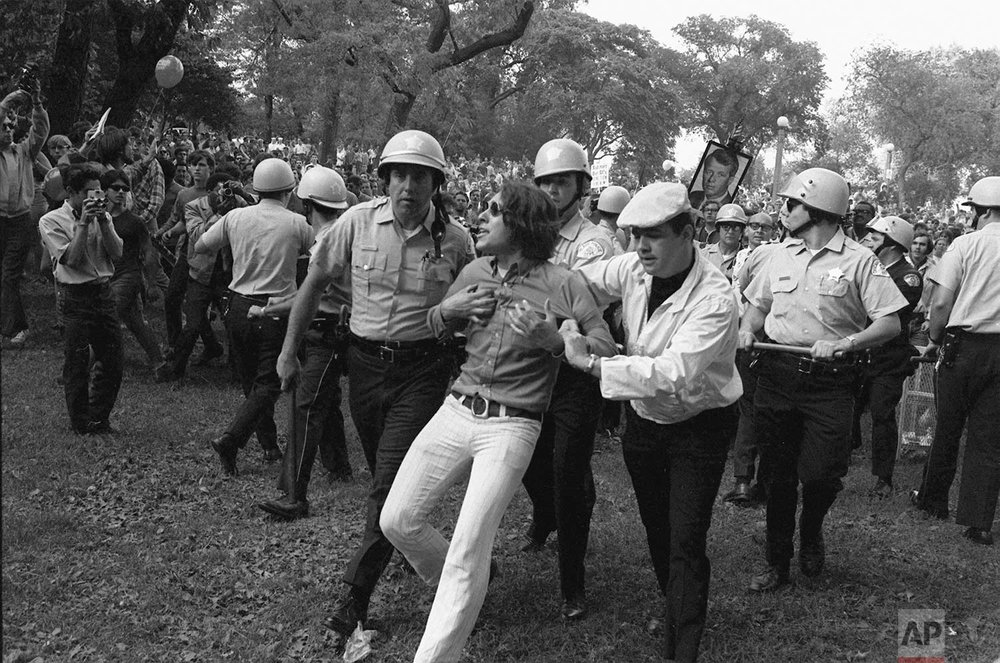 Chicago police lead a demonstrator from Grant Park during demonstrations that disrupted the Democratic National Convention in August 1968. The convention became the focal point of bitter confrontations between police and anti-war demonstrators. (AP Photo)