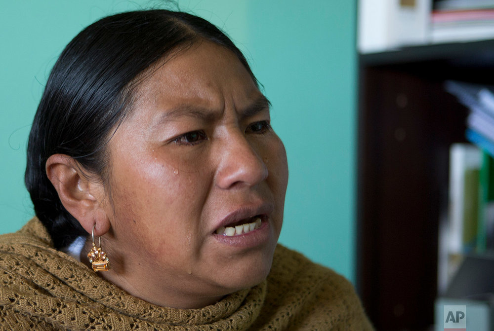 """In this June 23, 2018 photo, Councilwoman Mary de la Cruz, cries during an interview as she recalls the bullying and violence she suffered from the from the mayor, in Achocalla, Bolivia. """"The mayor is still free. It hurts my dignity,"""" she said. """"Justice must be served.""""(AP Photo/Juan Karita)"""