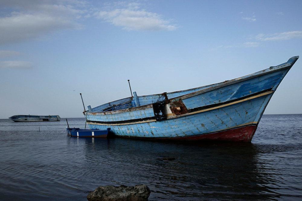 This Monday, April 16, 2018 photo shows a boat that carried migrants at the coastal city Monastir, Tunisia. (AP Photo/Nariman El-Mofty)