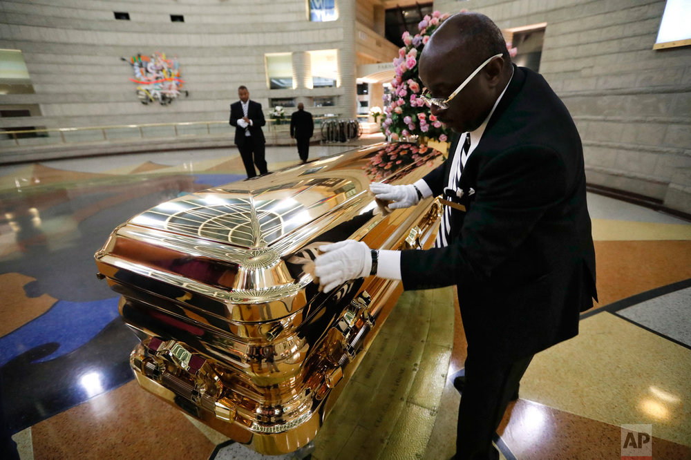 Vincent Street polishes the casket of legendary singer Aretha Franklin at the Charles H. Wright Museum of African American History in Detroit, Wednesday, Aug. 29, 2018. Franklin died Aug. 16, 2018 of pancreatic cancer at the age of 76. (AP Photo/Paul Sancya)