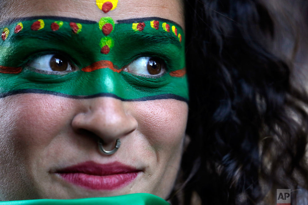 A woman attends a demonstration in support of decriminalizing abortion, outside the Argentine embassy in Quito, Ecuador, Aug. 8, 2018. Argentina's Senate is debating legislation that would legalize elective abortions in the first 14 months of pregnancy, an issue that bitterly divides the homeland of Pope Francis. (AP Photo/Dolores Ochoa)