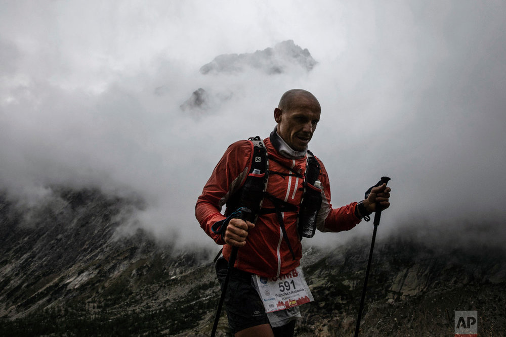 A competitor runs at the Grand Col Ferret as he competes in the 170km Ultra-Trail of Mont-Blanc (UTMB) race, near Courmayeur, Italy, Sept 1, 2018.(AP Photo/Laurent Cipriani)