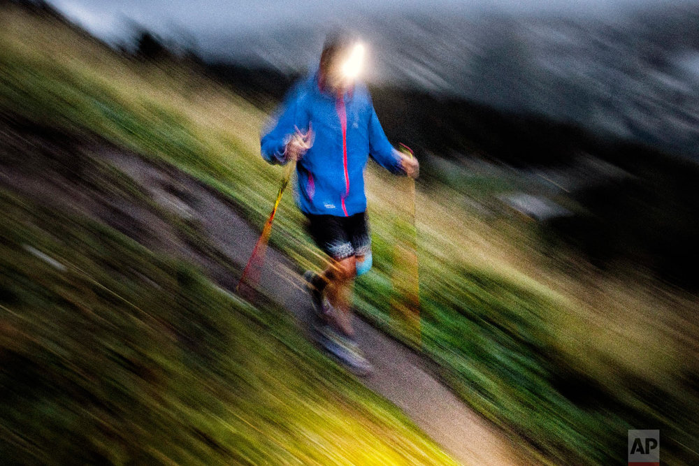 A competitor runs as he competes in the 170km Ultra-Trail of Mont-Blanc (UTMB) race, near Chamonix, French Alps, Sept 2, 2018.(AP Photo/Laurent Cipriani)