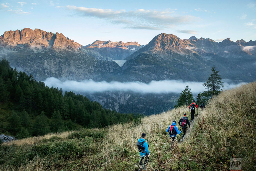 Competitors run as they compete in the 170km Ultra-Trail of Mont-Blanc (UTMB) race, near Chamonix, French Alps, Sept 2, 2018.(AP Photo/Laurent Cipriani)