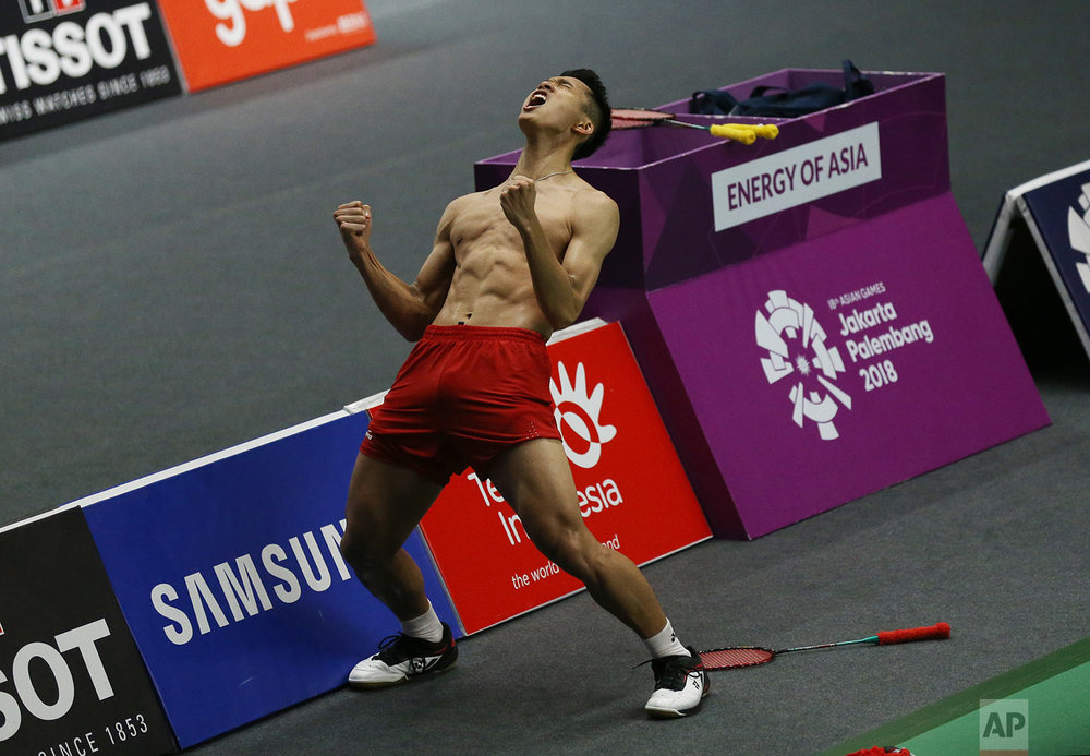 Jonatan Christie of Indonesia celebrates after defeating Kenta Nishimoto of Japan during their men's single semifinals badminton match at the 18th Asian Games in Jakarta, Indonesia, Monday, Aug. 27, 2018. (AP Photo/Achmad Ibrahim)