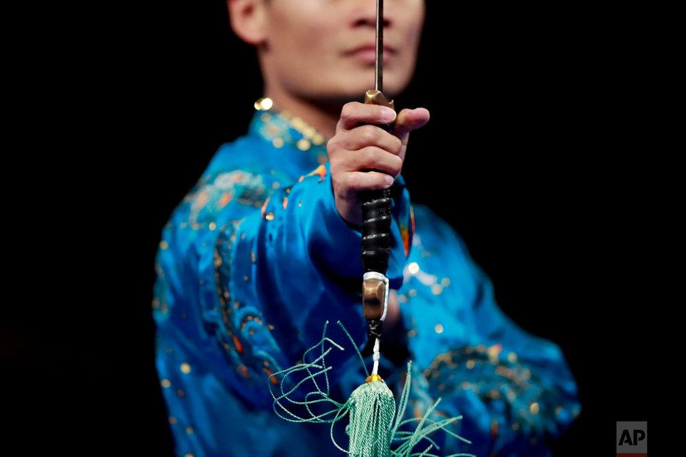 Kazahastan's Askarbay Yedibayev during his taijijian wushu performance at the 18th Asian Games in Jakarta, Indonesia, Wednesday, Aug. 22, 2018. (AP Photo/Bernat Armangue)