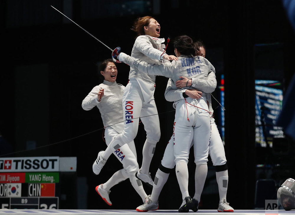 South Korea team women celebrates after defeating China team during their women's sabre team finals fencing match at the 18th Asian Games in Jakarta, Indonesia, Wednesday, Aug. 22, 2018. (AP Photo/Achmad Ibrahim)