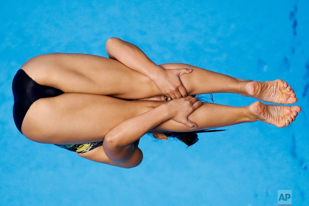 Malaysia's Nur Dhabitah Sabri competes during the women's 1m springboard diving at the 18th Asian Games in Jakarta, Indonesia, Friday, Aug. 31, 2018. (AP Photo/Bernat Armangue)